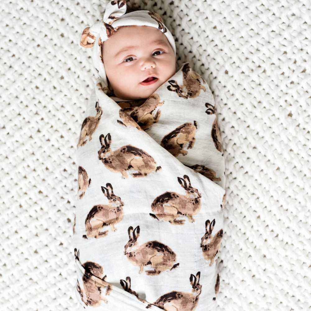 Newborn Baby in Milkbarn Kids Organic Cotton Swaddle Blanket in the Bunny Print